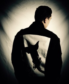 Man wearing Zhu limited edition year of the dog jean jacket.
